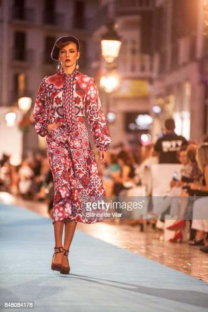 A model walks the runway in the Carmiña Romero fashion show during the VII Larios Malaga Fashion Week on September 16 2017 in Malaga Spain