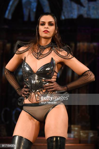 A model walks the runway in the Divamp Couture presentation during New York Fashion Week Powered by Art Hearts Fashion NYFW at The Angel Orensanz...