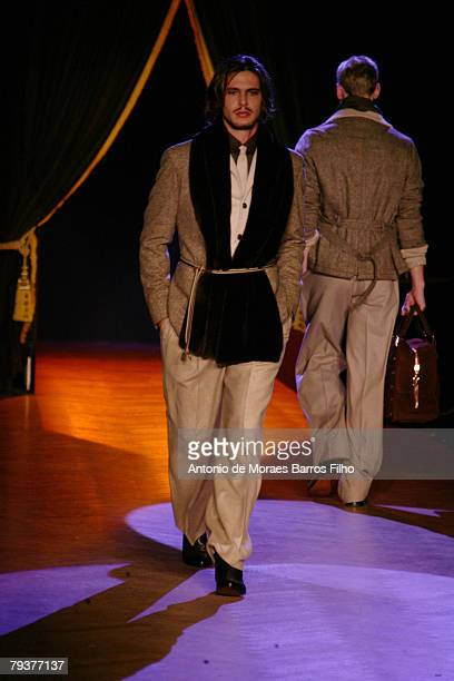 A model walks the runway in the Emanuel Ungaro Ready To Wear Menswear collection during Paris Fashion Week AutumnWinter 20082009 at the Westin Hotel...