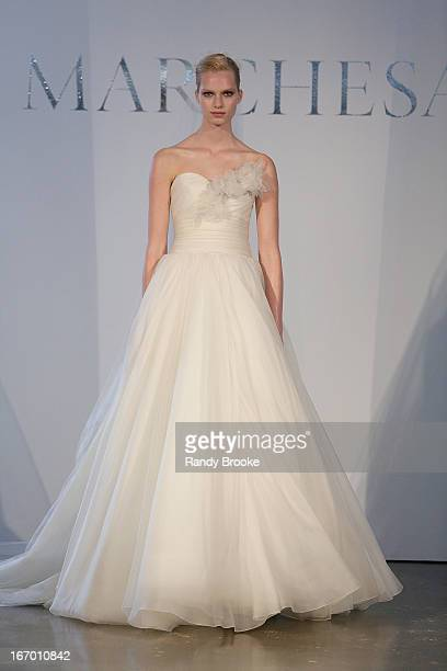 A model walks the runway in the first look during the Marchesa 2014 Bridal Spring/Summer collection show at Canoe Studios on April 19 2013 in New...