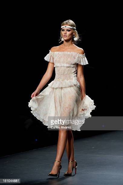 A model walks the runway in the Francis Montesinos fashion show during the MercedesBenz Fashion Week Madrid Spring/Summer 2013 at Ifema on August 31...
