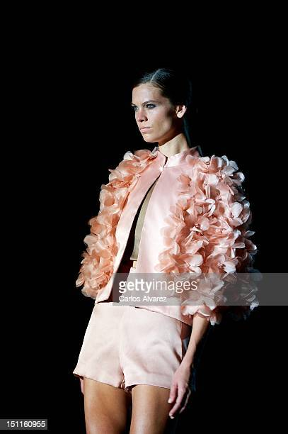 A model walks the runway in the Juana Martin fashion show during the MercedesBenz Fashion Week Madrid Spring/Summer 2013 at Ifema on September 2 2012...
