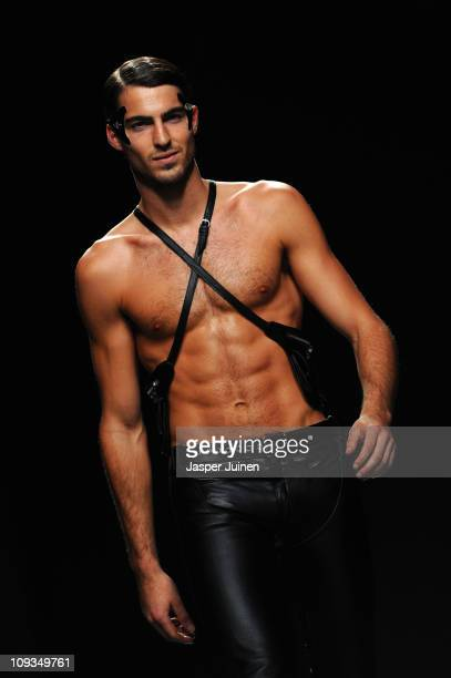Model walks the runway in the Martin Lamothe Carlos Diez fashion show during the Cibeles Madrid Fashion Week Autumn/Winter 2011 at the Ifema on...