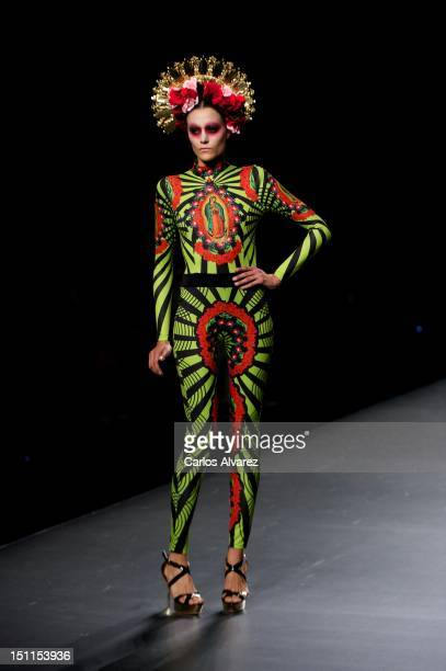 A model walks the runway in the Maya Hansen fashion show during the MercedesBenz Fashion Week Madrid Spring/Summer 2013 at Ifema on September 2 2012...