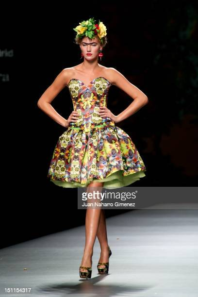 A model walks the runway in the Maya Hansen fashion show during the MercedesBenz Fashion Week Madrid Spring/Summer 2013 at Ifema on September 2 2012...