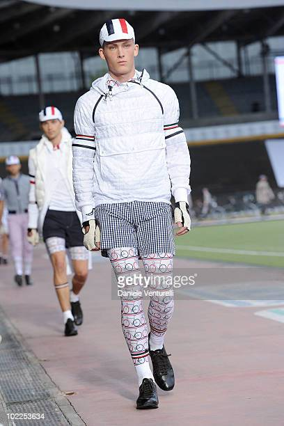 Model walks the runway in the Moncler Gamme Bleu show during Milan Fashion Week for Menswear Spring/Summer 2011 on June 20, 2010 in Milan, Italy.