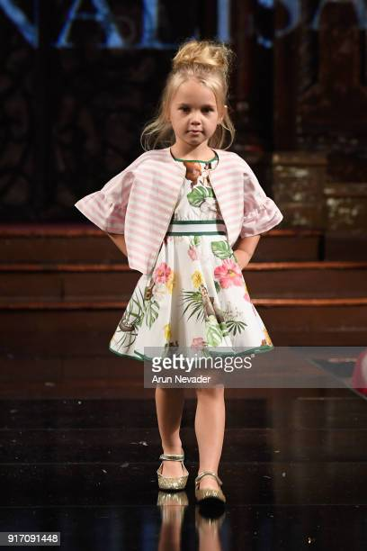 A model walks the runway in the Monnalisa presentation at New York Fashion Week Powered by Art Hearts Fashion NYFW at The Angel Orensanz Foundation...
