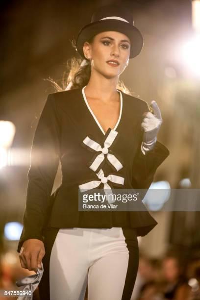 A model walks the runway in the Ángel Palazuelos fashion show during the VII Larios Malaga Fashion Week on September 15 2017 in Malaga Spain