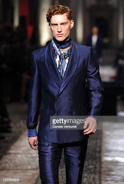 Model walks the runway in the Roberto Cavalli show during Milan Fashion Week for Menswear Spring/Summer 2011 on June 20, 2010 in Milan, Italy.