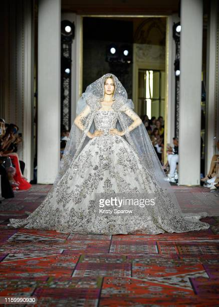 A model walks the runway in the wedding gown during the Zuhair Murad Fall/Winter 2019 2020 show as part of Paris Fashion Week on July 03 2019 in...
