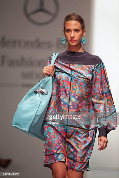 A model walks the runway of designer Arturo Ramos Miranda during the MercedesBenz Fashion Week Mexico Autumn/Winter 2012 at Hipódromo de las Americas...