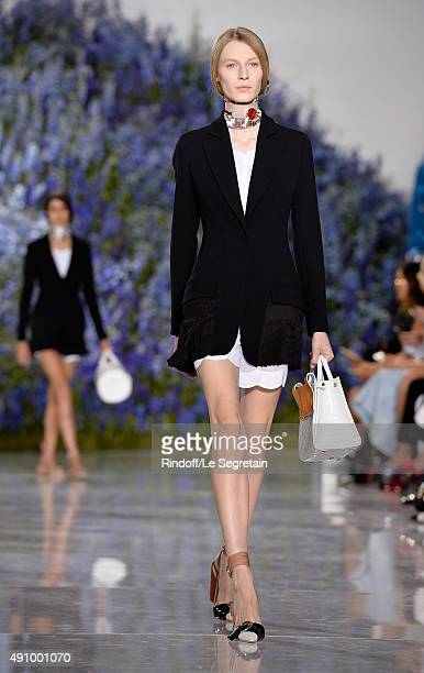 Model walks the runway of the Christian Dior show as part of the Paris Fashion Week Womenswear Spring/Summer 2016 at Cour Carree du Louvre on October...