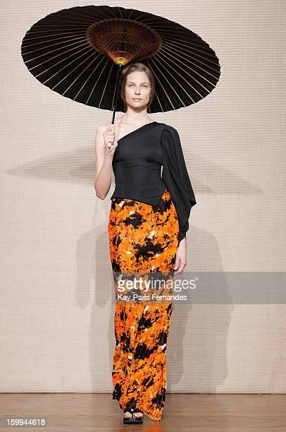 Model walks the runway of the Didit Hediprasetyo Spring/Summer 2013 Haute-Couture show as part of Paris Fashion Week at Shangri-La Hotel Paris on...