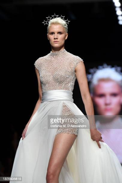 Model walks the runway of the Emiliano Bengasi show during the SiSposa Italia Collezioni - Milan Bridal Week on June 26, 2021 in Milan, Italy.