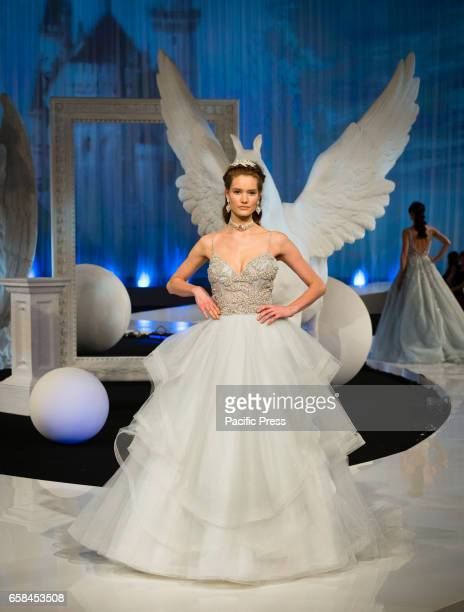 A model walks the runway of the 'Nicole Fashion Show'