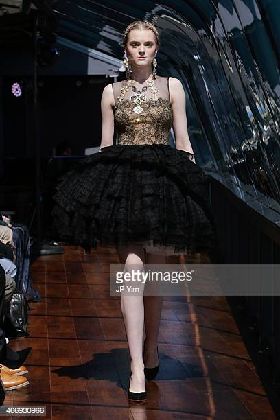 A model walks the runway on board a boat cruising along the Hudson River during the J Spring Fashion Show 2015 on March 19 2015 in New York City