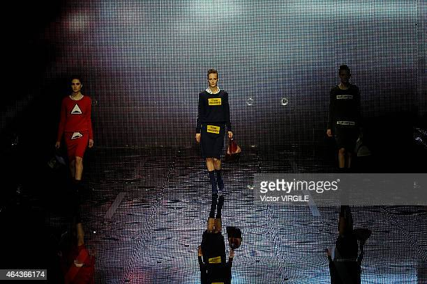 A model walks the runway presenting handbags and accessories at the Anya Hindmarch show during London Fashion Week Fall/Winter 2015/16 at on February...