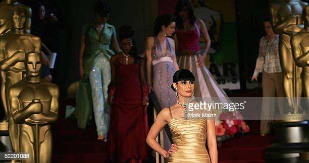 A model walks the runway previewing the styles and designers likely to predominate on the redcarpet at the 77th Annual Academy Awards at the Samuel...