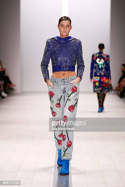 A model walks the runway showcasing designs by Discount Universe during MercedesBenz Fashion Week Weekend Edition at Carriageworks on May 21 2016 in...