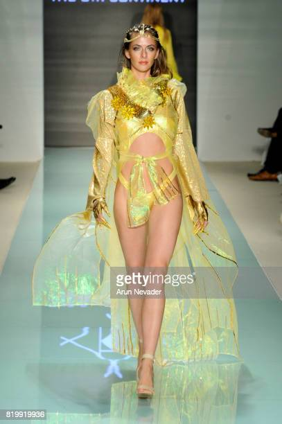Model walks the runway The 8th Continent At Miami Swim Week Art Hearts Fashion at FUNKSHION Tent on July 20, 2017 in Miami, Florida.
