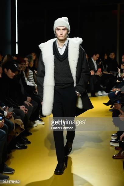 A model walks the runway the at BOSS Menswear February 2018 New York Fashion Week Mens' on February 7 2018 in New York City
