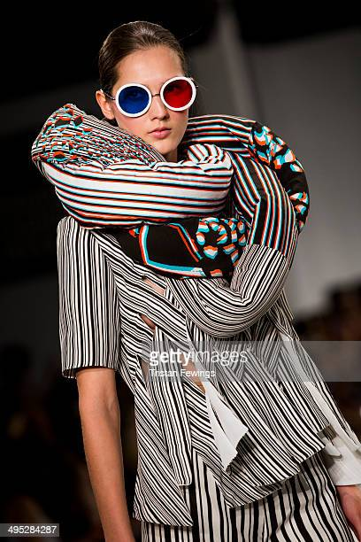 A model walks the runway wearing 3D designs by Rebecca Damla Saygi during the Nottingham Trent University show during day 3 of Graduate Fashion Week...