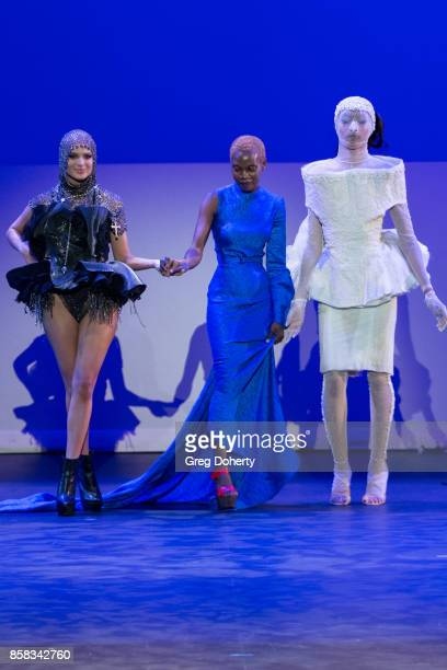 A model walks the runway wearing a Barbara L Ashley design at the Metropolitan Fashion Week Closing Night Gala at Arcadia Performing Arts Center on...