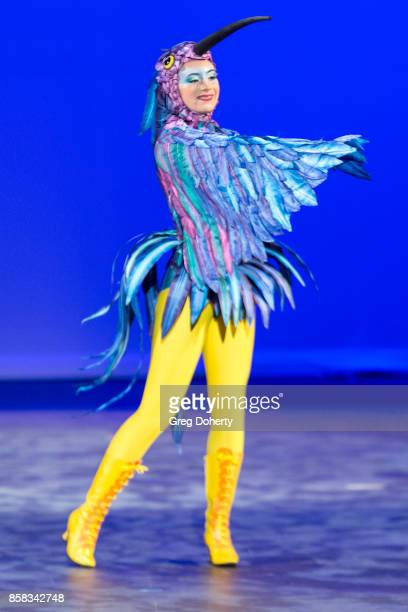 A model walks the runway wearing a costume inspired by LUZIA By Cirque du Soleil at the Metropolitan Fashion Week Closing Night Gala at Arcadia...