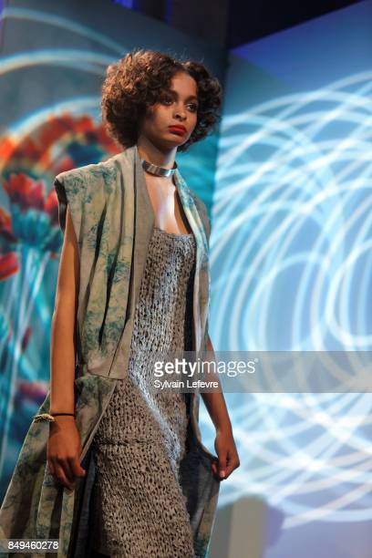 A model walks the runway wearing a creation by Demeure during the 10th '48h Maisons De Mode' fashion show on September 15 2017 in Lille France