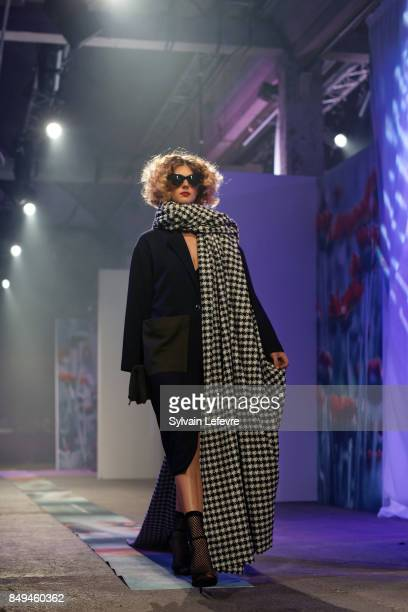 A model walks the runway wearing a creation by Edie Grim during the 10th '48h Maisons De Mode' fashion show on September 15 2017 in Lille France