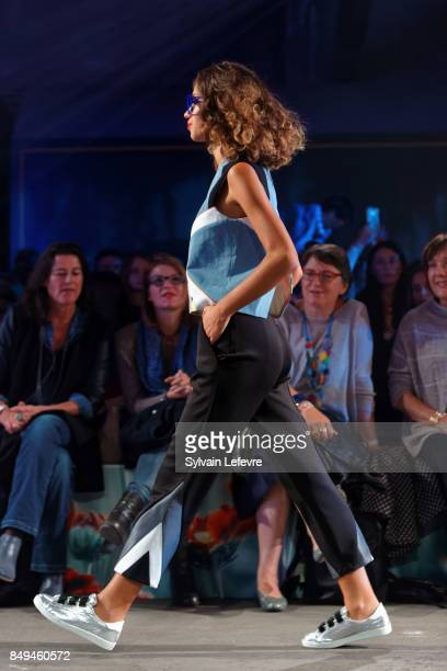 A model walks the runway wearing a creation by Tricote moi un tatoo during the 10th '48h Maisons De Mode' fashion show on September 15 2017 in Lille...