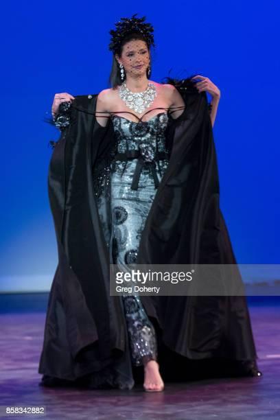 A model walks the runway wearing a David Tupaz design at the Metropolitan Fashion Week Closing Night Gala at Arcadia Performing Arts Center on...