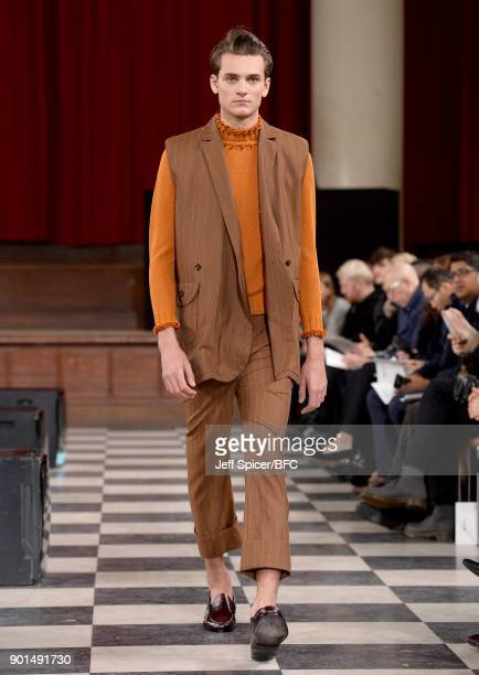 A model walks the runway wearing a design by Coline Gauthier at the LCFMA18 Menswear show during London Fashion Week Men's January 2018 at St John's...