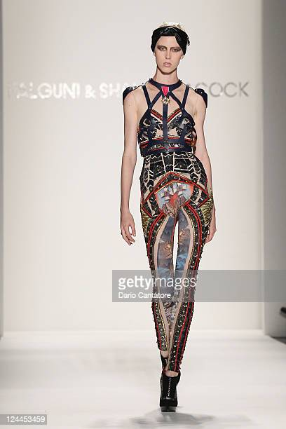 A model walks the runway wearing a design by Falguni and Shane Peacock Spring 2012 fashion show during MercedesBenz Fashion Week at Lincoln Center on...