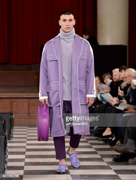 A model walks the runway wearing a design by Han Xu at the LCFMA18 Menswear show during London Fashion Week Men's January 2018 at St John's Smith...