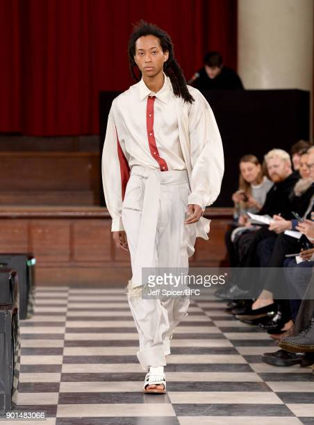 A model walks the runway wearing a design by Hanni Yang at the LCFMA18 Menswear show during London Fashion Week Men's January 2018 at St John's Smith...