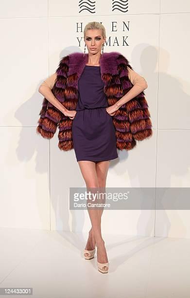 A model walks the runway wearing a design by Helen Yarmak International Spring 2012 fashion show during MercedesBenz Fashion Week at Lincoln Center...