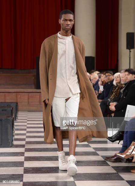 A model walks the runway wearing a design by Hengmin Lu at the LCFMA18 Menswear show during London Fashion Week Men's January 2018 at St John's Smith...