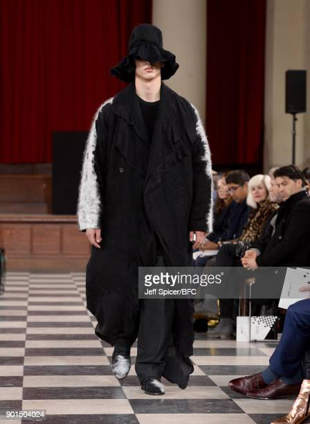 A model walks the runway wearing a design by Ming Lai Lee at the LCFMA18 Menswear show during London Fashion Week Men's January 2018 at St John's...