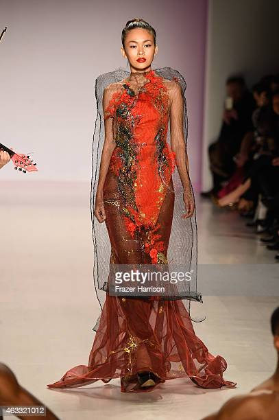 Model walks the runway wearing a design by Quynh Paris at the Charity Water fashion show during Mercedes-Benz Fashion Week Fall 2015 at The Salon at...