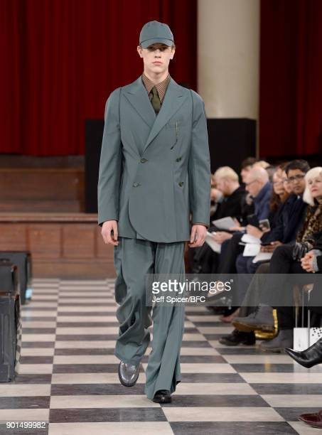 A model walks the runway wearing a design by Sohyeon Park at the LCFMA18 Menswear show during London Fashion Week Men's January 2018 at St John's...