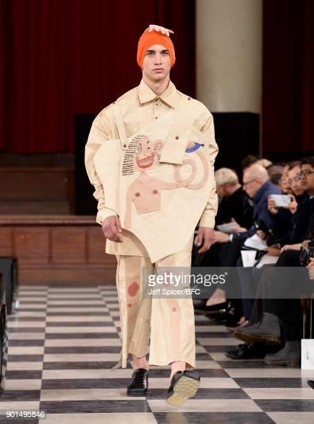 A model walks the runway wearing a design by Wenya Huang at the LCFMA18 Menswear show during London Fashion Week Men's January 2018 at St John's...