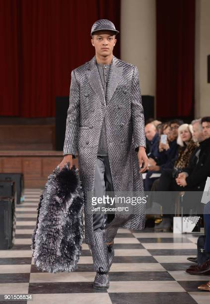 A model walks the runway wearing a design by Xu Bo at the LCFMA18 Menswear show during London Fashion Week Men's January 2018 at St John's Smith...