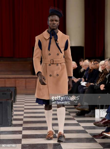 A model walks the runway wearing a design by Yingyi Lu at the LCFMA18 Menswear show during London Fashion Week Men's January 2018 at St John's Smith...
