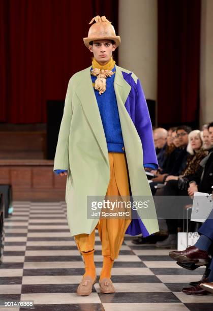 A model walks the runway wearing a design by Yixin Zhang at the LCFMA18 Menswear show during London Fashion Week Men's January 2018 at St John's...