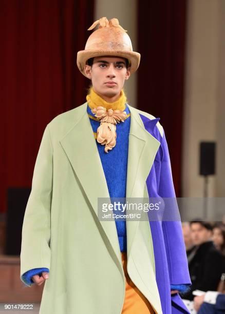 A model walks the runway wearing a design by Yixin Zhang at the LCFMA18 Menswear show during London Fashion Week Men's January 2018 at St John's...
