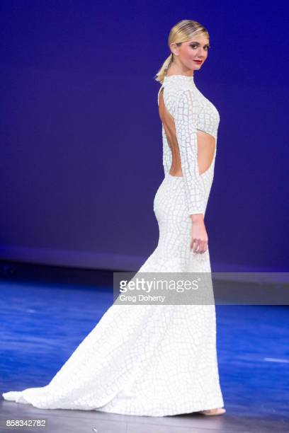 A model walks the runway wearing a Douglas Tapia design at the Metropolitan Fashion Week Closing Night Gala at Arcadia Performing Arts Center on...