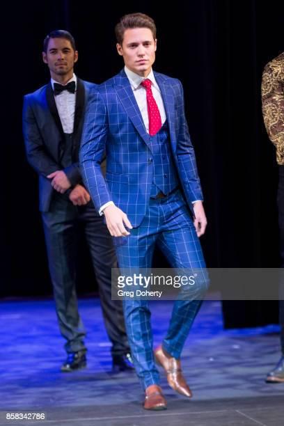 A model walks the runway wearing a Giovanni Testi design at the Metropolitan Fashion Week Closing Night Gala at Arcadia Performing Arts Center on...