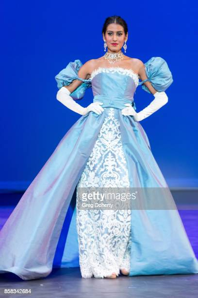 A model walks the runway wearing a Joey Galon design at the Metropolitan Fashion Week Closing Night Gala at Arcadia Performing Arts Center on October...