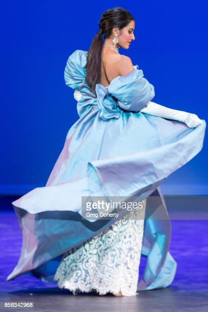 A model walks the runway wearing a Joey Galon design at the Metropolitan Fashion Week Closing Night Gala at Arcadia Performing Arts Center on October...